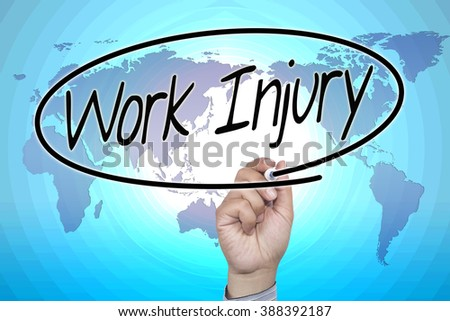 Man Hand writing Work Injury with marker on visual screen. Isolated on office. Business, technology, internet concept. Stock Photo - stock photo