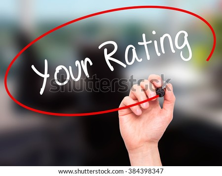 Man Hand writing Your Rating with black marker on visual screen. Isolated on background. Business, technology, internet concept. Stock Photo - stock photo