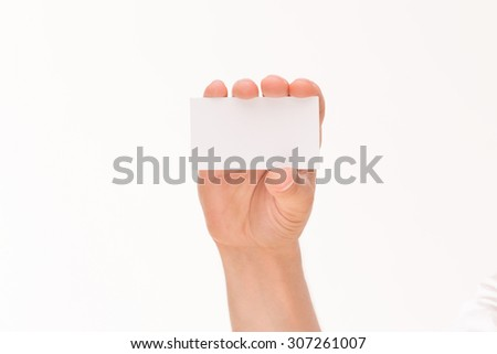 Man handing a blank card isolated on white background. Man's hand keeping a business card among all fingers. - stock photo