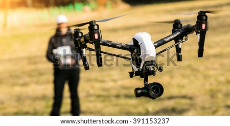Man handling drone in nature - stock photo