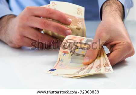 Man handling money. - stock photo
