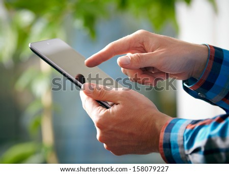 Man hands and tablet PC - stock photo