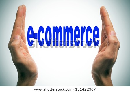 man hands forming brackets and the word e-commerce written between them - stock photo