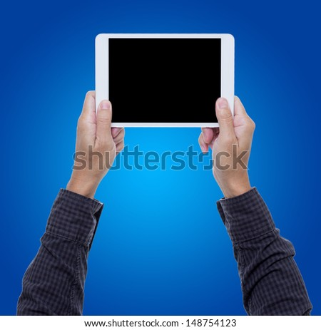 Man hands hold digital tablet isolated on blue background with clipping path - stock photo