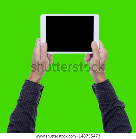 Man hands hold digital tablet isolated on green background with clipping path - stock photo