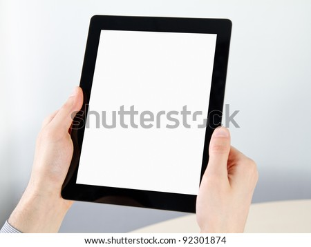 Man hands holding electronic digital frame with blank screen. - stock photo