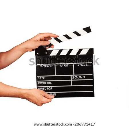 Man hands holding film clapper isolated on white background - stock photo