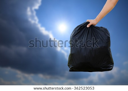 Man hands holding garbage bag. - stock photo