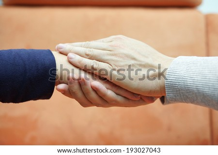 man hands holding  woman hand from both sides. Compassion and  concern concept - stock photo