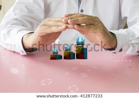 Man hands protect piggy bank. Finance concept of savings or good credit. - stock photo