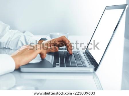 man hands pushing keys of laptop - stock photo