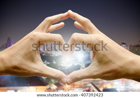 Man hands shaping a heart symbol on white background - stock photo