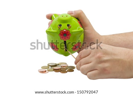 Man hands taking Euro coins from a piggy bank isolated on white background - stock photo