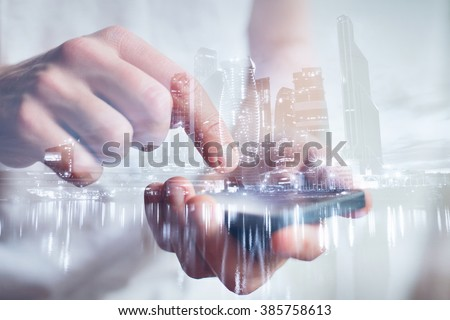 man hands touching smartphone, closeup, double exposure with modern city skyline - stock photo