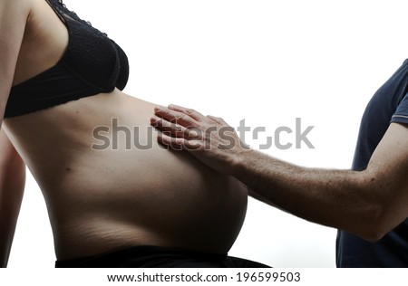 man hands touching stomach his pregnant woman on white background - stock photo
