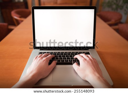 Man hands using, working on laptop with blank screen in home living room. first person view. - stock photo