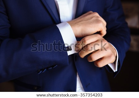 Man hands with cufflinks. Elegant gentleman clother - stock photo