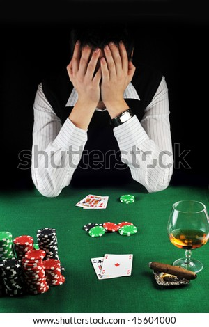 man  has lost in cards - stock photo