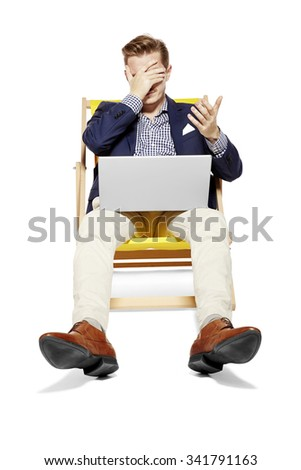 Man has problems at work during his holidays. Gesturing by hands.  - stock photo