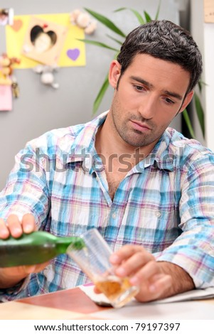 Man having a beer - stock photo