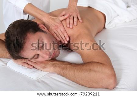 Man having a massage - stock photo