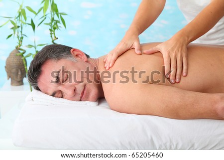 Man having a massage in a spa center - stock photo