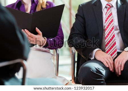 Man having an interview with manager and partner employment job candidate hiring resume CEO work business closeup cutout - stock photo