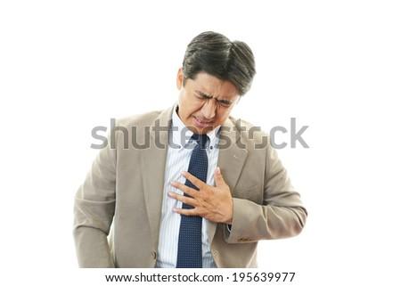 Man having chest pain - stock photo