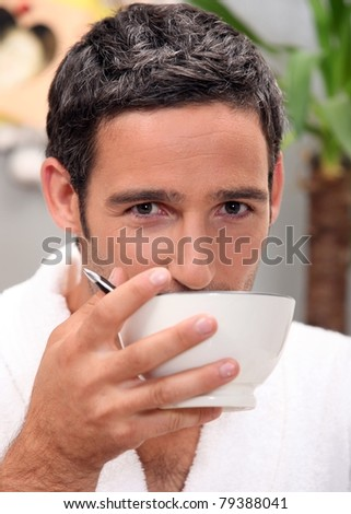 Man having cup of coffee at home - stock photo