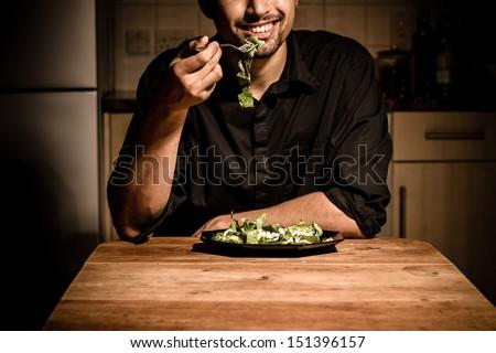 Man having dinner at home - stock photo