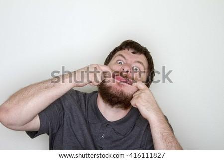 Man having fun making a funny face - stock photo