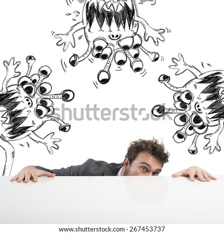 Man hides fearful of the flu virus - stock photo