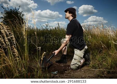 Man hiding his drug contraband - stock photo
