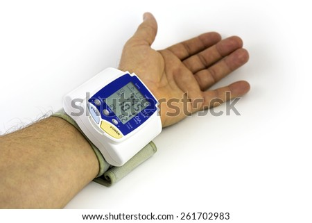 Man himself measured his own blood pressure on a wrist - stock photo