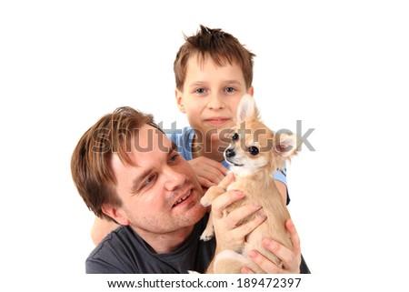 man, his son and chihuahua - stock photo