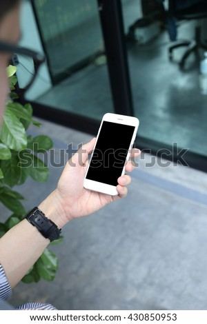 Man hloding and using smartphone - stock photo