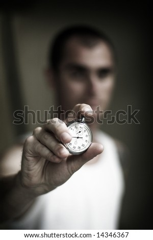 man hold a chronometer ,shallow Dof - stock photo