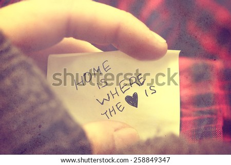 man hold hand draw quote, filtered love background  - stock photo