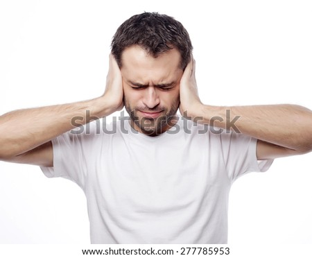 man hold hands on temples ears, concept of man stressed, headache, depressed, pain, closed eyes wear white t-shirt, isolated on white. - stock photo