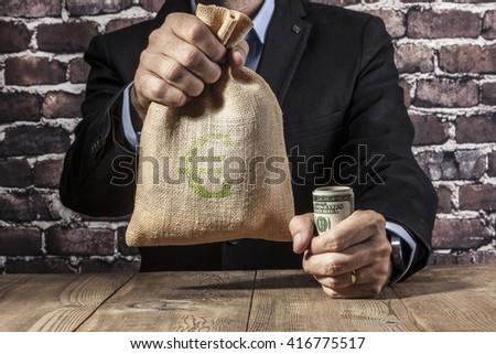 Man holding a big sack of money - stock photo