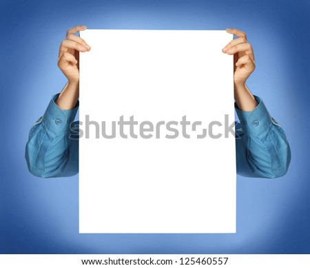 Man holding a blank sheet of paper to enter your message - stock photo