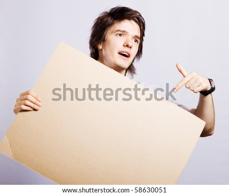 man holding a card, good space for writing or placing an image - stock photo