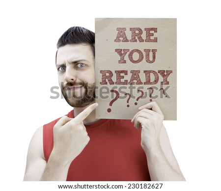 Man holding a card with the text Are you Ready? on white background - stock photo