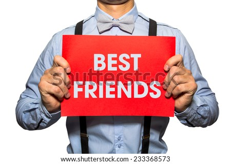 Man holding a card with the text Best friends y on white background - stock photo