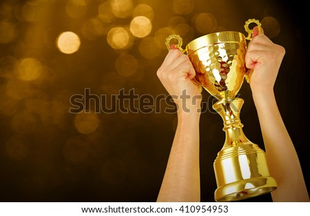 Man holding a champion golden trophy  - stock photo
