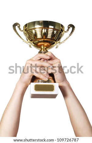 Man holding a champion golden trophy on white background - stock photo