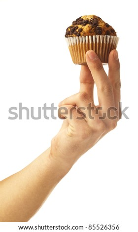 man holding a chocolate muffin on white background - stock photo