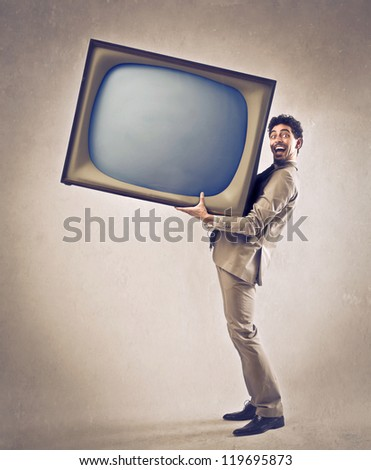 Man holding a giant CRT - stock photo