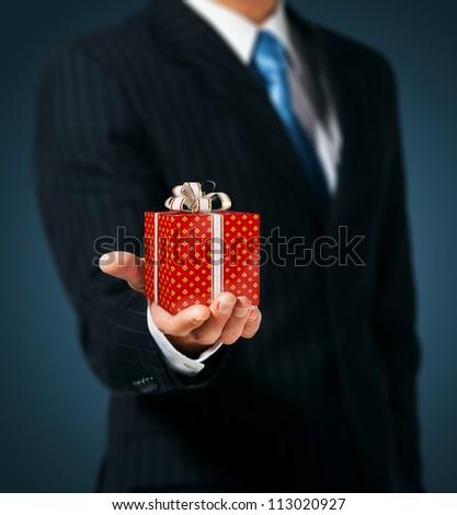 Man holding a gift box - stock photo