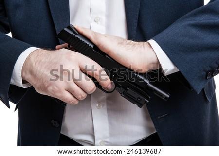 man holding a gun on a white background - stock photo